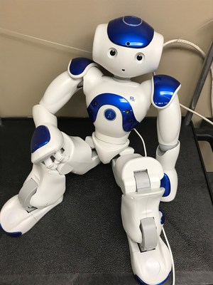 "Due to his critical illness, Mason was eligible to have a wish granted by Make-A-Wish. In November of last year, the seven-year-old from Prince Albert, Sask. wished to give a humanoid robot called MEDi to Royal University Hospital in Saskatoon and name it ""Nurse Mason"". (CNW Group/Make-A-Wish Canada)"