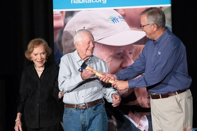 President and Mrs. Carter mark the announcement of the 2019 Carter Work Project by passing a hammer to Danny Herron, president and CEO of Habitat for Humanity of Greater Nashville. The announcement came at the closing ceremony of the 2018 project in Indiana.