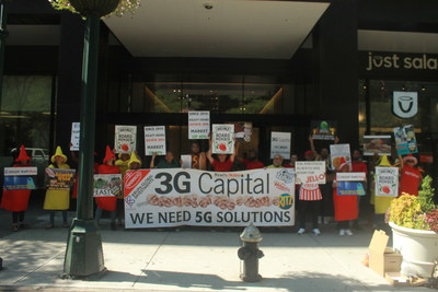 Demonstrators hold signs outside 3G Capital offices in New York, NY