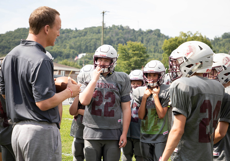 Riddell brand ambassador Peyton Manning (left) surprised Rogersville Middle School of Rogersville, Tennessee with new football equipment as part of Riddell's 2018 Smarter Football program on August 24.