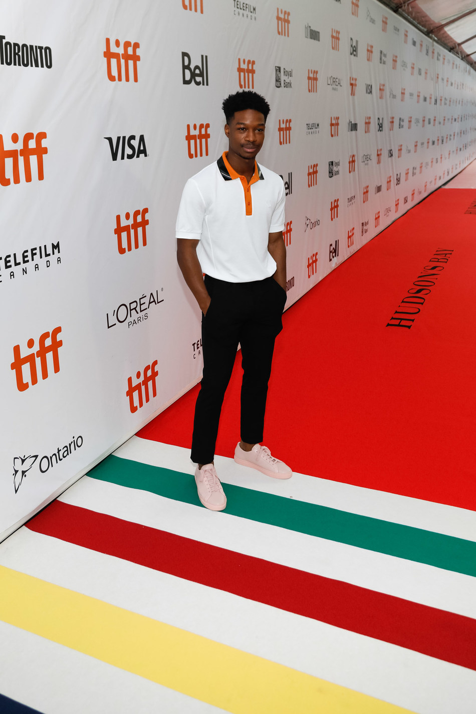 TIFF Rising Star Lamar Johnson, The Hate U Give, is the first to walk the Hudson's Bay signature striped carpet at Roy Thomson Hall. (Photo credit: George Pimentel Photography) (CNW Group/Hudson's Bay)