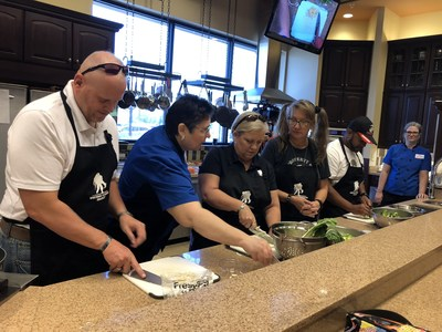 Warriors learn to create the perfect stir fry during Wounded Warrior Project event