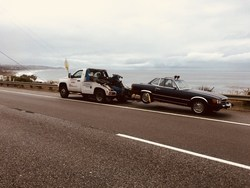 Towing Services in Los Angeles: One of our wheel lift trucks, assisting a client with his classic vehicle along the Pacific cost Highway 1