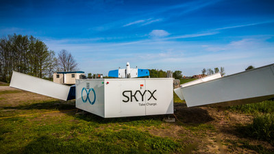 """SkyOne, SkyX's Vertical Take-Off and Landing (VTOL) Unmanned Aerial Vehicle, sits aboard the xStation. The station enables SkyOne to remotely recharge and perform diagnostics. With multiple xStations in the field, SkyOne can fly 100s, even 1000s of kilometres without having to """"return to home."""" The company, based in the Greater Toronto Area, has just secured $9.5 (USD) in Series B funding to expand. (CNW Group/SkyX)"""