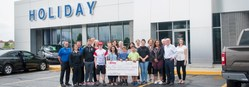 Faculty, staff, students and parents accepted the check from Ford at Holiday Ford in late August.
