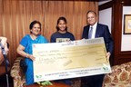 Mr. K. S. Rathee honouring Swapna Barman - Asian Games Gold Medalist. (PRNewsfoto/ASK Automotive Pvt. Ltd.)