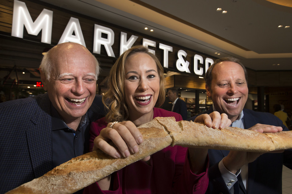 From left to right, Tony Van Bynen, Mayor of Newmarket; Bri-Ann Stuart, Director & General Manager Upper Canada; and Bradley Jones, Head of Retail Oxford Properties break bread to celebrate the grand opening of Market & Co. at Upper Canada. (CNW Group/Oxford Properties)