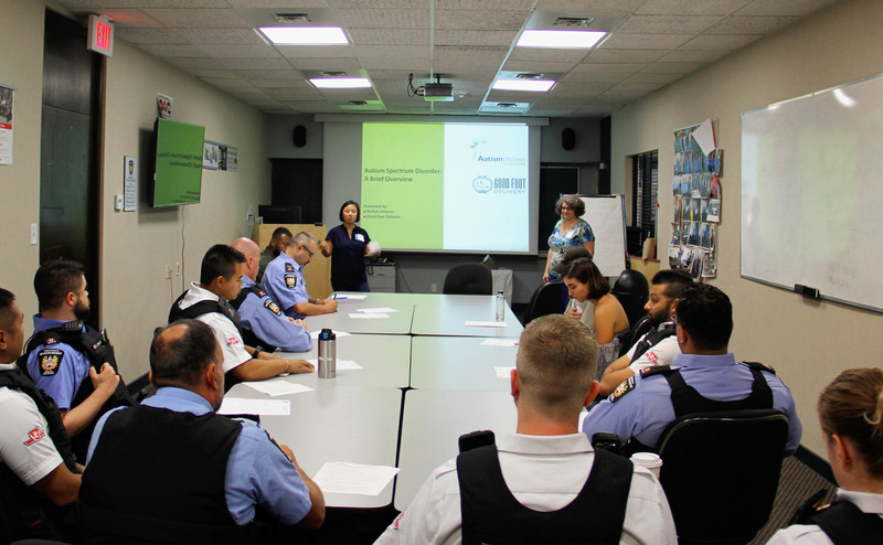Good Foot Ops Manager, Courtney Ayukawa presenting to the TTC special constables and fare inspectors (CNW Group/Good Foot Support Services)