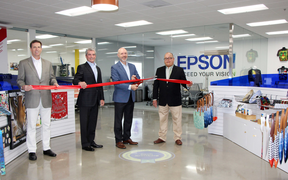Keith Kratzberg, president and CEO of Epson America, cuts the ribbon at opening of new Epson Technology Center in Carson, Calif.