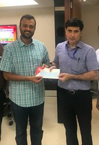 Harsh Jain (left), Co-founder and CEO, Dream11, presenting the cheque to Mr. Bhushan Gagrani, Principal Secretary to the Maharashtra Chief Minister. (PRNewsfoto/Dream11)