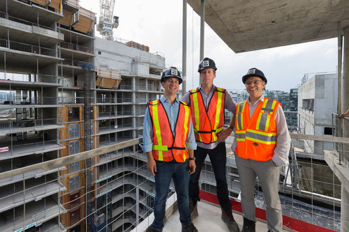 Paul Baron, VP of Asset Management (Minto Capital), Glen MacMullin, SVP of Investment Management (Minto Capital) and Frank Pagliuca, VP of Construction (Minto Communities) standing in front of 39 Niagara rental offering. (CNW Group/The Minto Group)