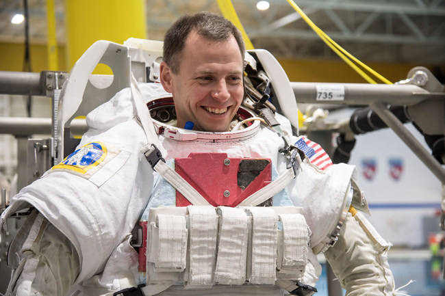 NASA astronaut Nick Hague gets into a spacesuit for spacewalk training in the Neutral Buoyancy Laboratory at NASA's Johnson Space Center in Houston on Dec. 7, 2017. Hague is set to launch to the International Space Station Oct. 11, 2018, on his first spaceflight. Credit: NASA