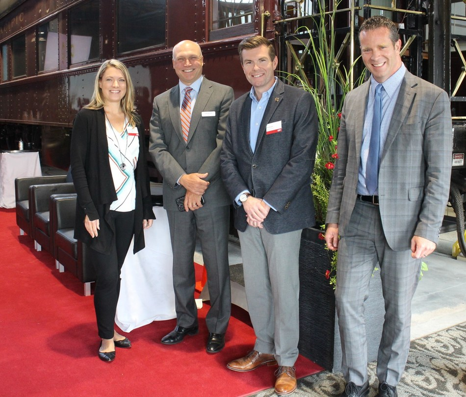 Carrie Evans, VP Sales and Marketing, Iowa Interstate Railroad, far left, joins CP's Chief Marketing Officer John Brooks, Joe Parsons, GM Iowa Interstate Railroad and CP's VP of Market Strategy and Asset Management Mike Foran, far right, for a photo during  the CP Reconnect 2018 Short Line and Regional Railroad  Conference in Calgary. Sept. 10, 2018. (CNW Group/Canadian Pacific)