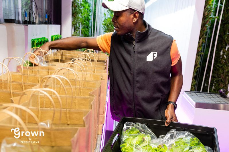 Joshua Fiagbedzi, one of the first Grown farmers, packs farm shares mere minutes after harvest. More than 50 customers will enjoy his crop, grown by a farmer they know, transported just 100 yards from farm to fork.