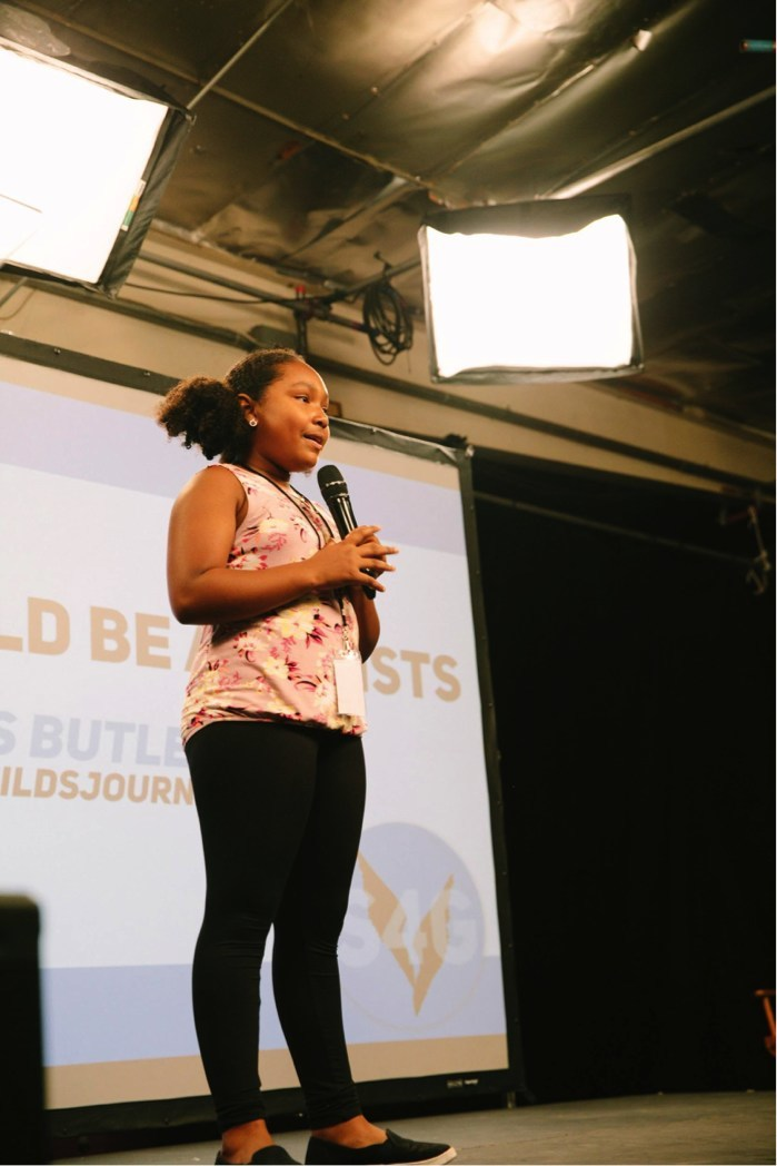 Genesis Butler, aged 11, addresses participants at the first ever Dairy Free Athlete Summit in Los Angeles, CA. Ms. Butler, popular vegan activist and public speaker, is the youngest person ever to give a TedX Talk. Credit: Alexandra Foley, Switch4Good.