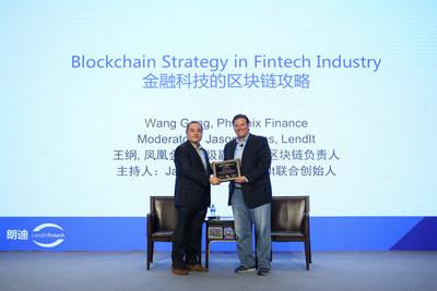 Wang Gang, SVP of Phoenix Finance and the head of blockchain business, presents a certificate of blockchain global strategic advisor to LendIt co-fouder Jason Jones.