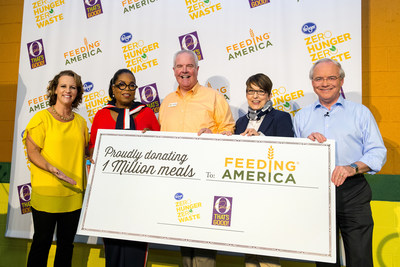 Jessica Adelman, Kroger's social impact officer; Oprah Winfrey; Kurt Reiber, Freestore Foodbank's president and CEO; Kelli Walker, Feeding America's corporate partnerships director; and Rodney McMullen, Kroger's chairman and CEO seen at Kroger's Zero Hunger Zero Waste anniversary celebration at the Freestore Foodbank on Tuesday, Sept.11, 2018 in Cincinnati. AP Images