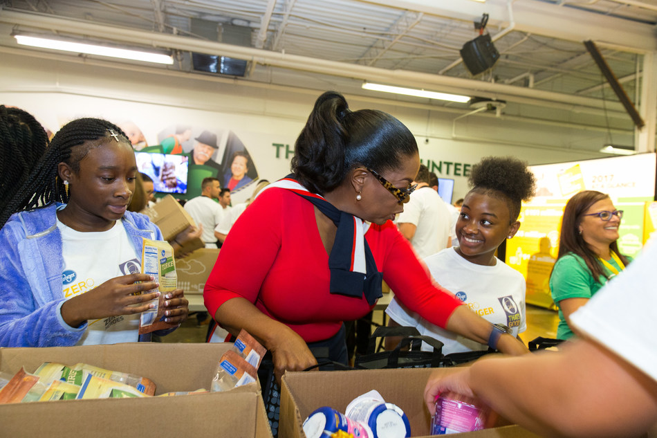 Oprah Winfrey joins 100 volunteers from the community and School for Creative and Performing Arts to celebrate the one-year anniversary of Kroger's Zero Hunger Zero Waste initiative at the Freestore Foodbank on Tues., Sept. 11, 2018 in Cincinnati. AP Images
