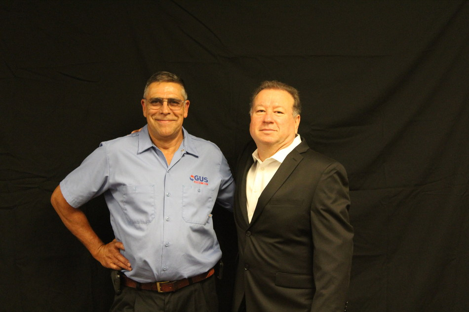 Jerry Hall (right) and Assured Comfort Heating, Air & Plumbing announce their acquisition of Gus HVAC, owned by Gus Suarez (left), as the leading home services company expands to Canton and Alpharetta.