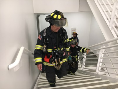 Lt. Emmett Larkin of Sunnyvale DPS leads a team up the stairs at Moffett Towers II Building 1 during a high-rise firefighting exercise.