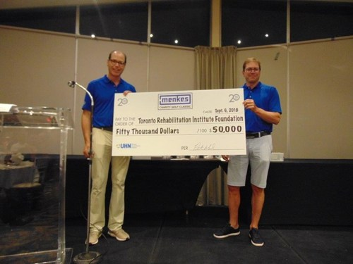 Steven Menkes, President Low Rise Division and Peter Menkes, President, Commercial /Industrial Division present a cheque to Toronto Rehab Foundation, one of three organizations benefiting from the event. (CNW Group/Menkes Developments Ltd)