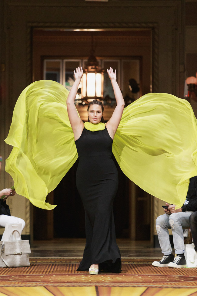 Candice Huffine makes a dramatic entrance at the Christian Siriano show wearing limited-edition, direct from runway platforms from the Payless collection.