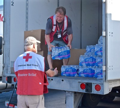 Mary Bos, a Red Cross logistics volunteer, unloads a pallet of water in Charleston, S.C. Her husband is a logistics lead volunteer for the Red Cross and taught her how to use a forklift.  Red Cross photo by Bob Wallace