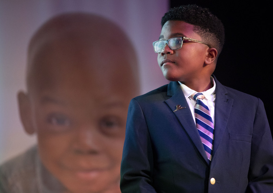St. Jude patient, Dallas, looks on as members of The Links and the National Pan-Hellenic Council are honored for their commitment to end sickle cell disease during sickle cell awareness and childhood cancer awareness month.