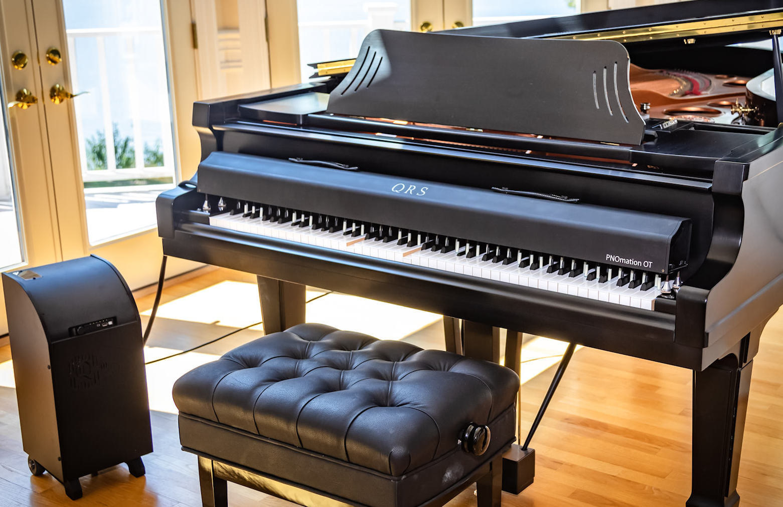 QRS combines its PNOmation player piano platform, music with some distinctive mechanical designs to deliver a truly unique product, PNOmation OT(Over the Top) a portable player piano system. PNOmation OT can convert just about any 88-note keyboard into a player piano in minutes.