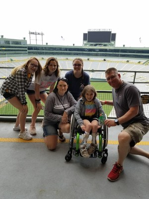 Retired National Guard veteran, Mike Zientek with his family at Lambeau Field during Wounded Warrior Project tour.