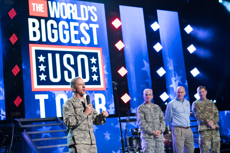 General David Goldfein, Chief of Staff of the Air Force engages with the audience before the concert. Live-looks into three remote USO locations – USO Camp Arifjan in Kuwait, USO Yokosuka in Japan, and USO Alaska Joint Base Elmendorf Richardson –  were led by General Paul Selva, Vice Chairman of the Joint Chiefs of Staff, General David Goldfein, Chief of Staff of the U.S. Air Force, General George William Casey, Jr., USA (ret.). USO photo by Cherie Cullen.