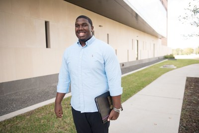 Graduate student captured with all smiles on his way to class.