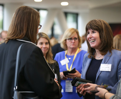 """Mary Ann Kirsch (right), Director of Global Services Purchasing at FCA US LLC, networks with women leaders at the Company's """"W2W Mixer"""" held Thursday, Sept. 13, 2018 during the 19th annual MatchMaker supplier diversity event. Created by the FCA Women's Alliance business resource group, the event linked women business owners with top FCA female leadership."""