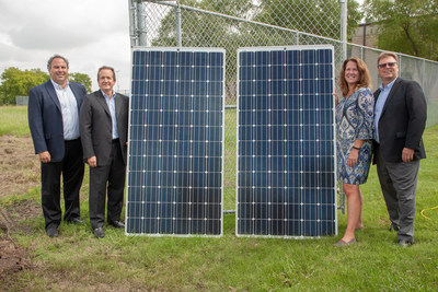 Tetra Pak leadership with two of the 1,862 solar panels that will be installed at Tetra Pak's U.S. & Canada headquarters in Denton, Texas Pictured (left to right): Jason Pelz - vice president of circular economy, Tetra Pak Americas & Southeast Asia and Oceania; Adolfo Orive - vice president, Tetra Pak Americas; Carmen Becker - president and CEO, Tetra Pak U.S. & Canada; Charles Posey - vice president or supply chain operations, Tetra Pak Americas