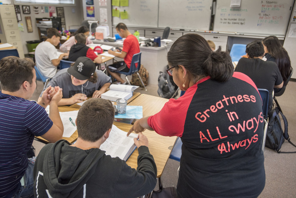 """Students at Galt High School in Galt, California work out math problems with the guidance of a teacher's aide. Stanford University released a comprehensive report on PreK-12 education on Sept. 17, 2018, entitled """"Getting Down to Facts II,"""" containing a snapshot of the state's education system.  Photo by Bryan Patrick (PRNewsfoto/Stanford University)"""
