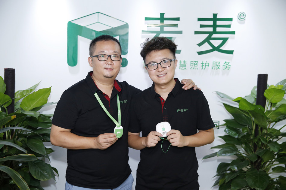 """The CEO He Wei (on the left) and CTO Li Guangpeng of """"Internet plus Aged care"""" start-up enterprise Magicare"""