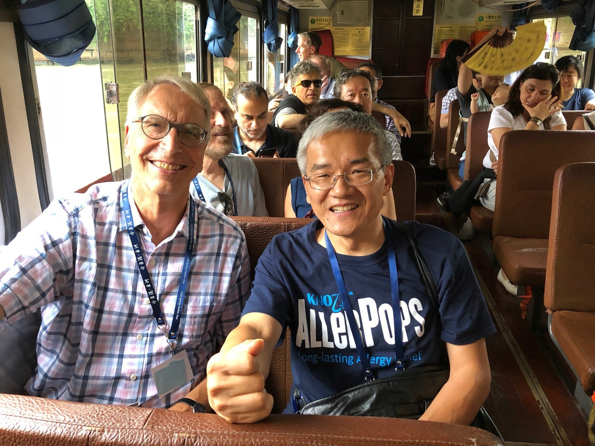 Fellow meeting participants, Dieter kabelitz (left) and Cliff Han toured Suzhou on a riverboat.