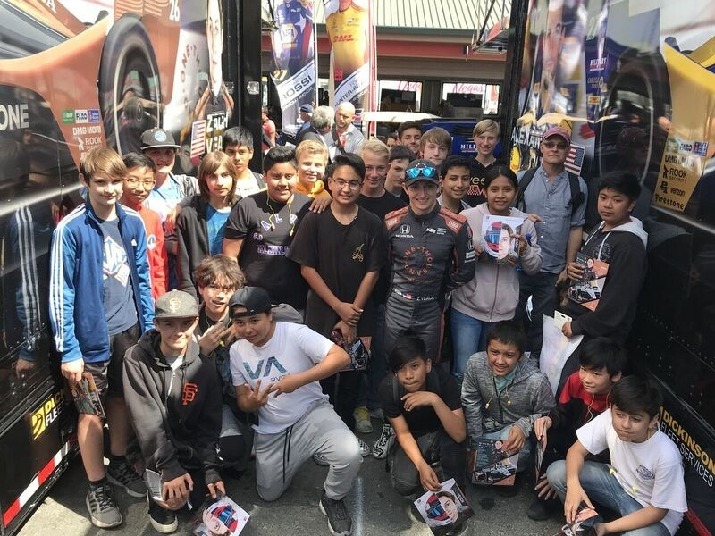 Sonoma area children meet with IndyCar driver Zach Veach (center) to learn about the importance of STEM.
