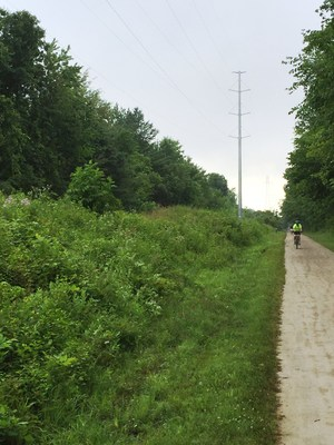 Electric transmission lines and railroad corridors often coexist, and when the trains stop running these corridors become ideal spaces for trails and sustainable greenways.