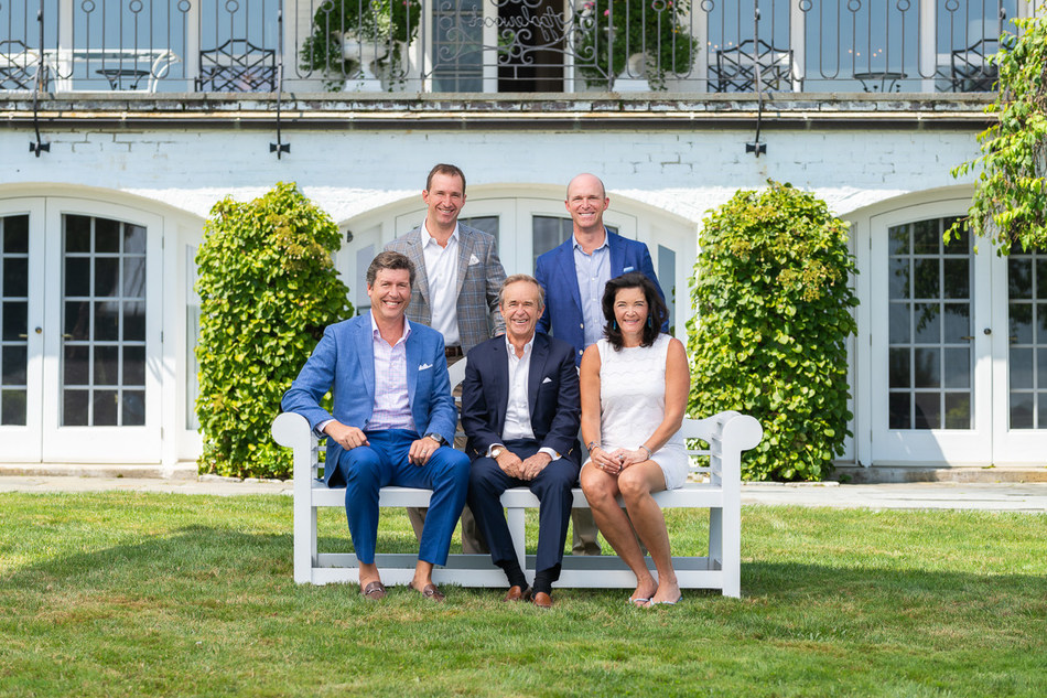 William Raveis Real Estate partners with Palm Beach-based The Fite Group Luxury Homes. (seated left to right) David Fite, Principal, The Fite Group; William Raveis, Chairman & CEO, William Raveis Real Estate; Nadine Fite, Chief Marketing Officer, The Fite Group; (standing left to right) Ryan Raveis, Co-President, William Raveis Real Estate; Chris Raveis, Co-President, William Raveis Real Estate.
