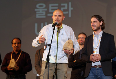"""Balazs Simonyi, director of the documentary film """"Ultra,"""" speaks after winning the grand prize in the international competition section during the closing ceremony of the 3rd Ulju Mountain Film Festival. (PRNewsfoto/2018 Ulju Mountain Film Festiva)"""