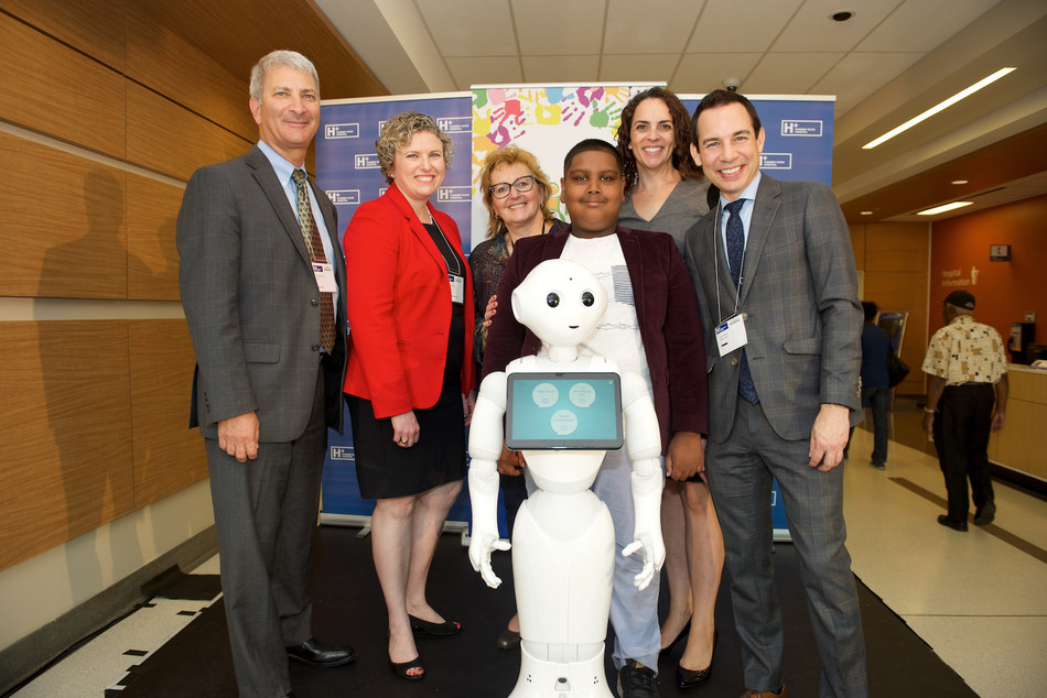 Humber River Hospital Joins Kids Health Alliance -  Enhancing Access to Paediatric Care, Closer to Home L-R Dr. Michael Apkon, President and CEO, SickKids, Julia Hanigsberg, President and CEO, Holland Bloorview Kids Rehabilitation Hospital, Barb Collins, President and CEO, Humber River Hospital, Pepper the Robot, Andrew Alguram, Patient, Humber River Hospital, Lauren Ettin, Executive Director, Kids Health Alliance, Alex Munter, President and CEO, Children's Hospital of Eastern Ontario (CHEO) (CNW Group/Humber River Hospital)