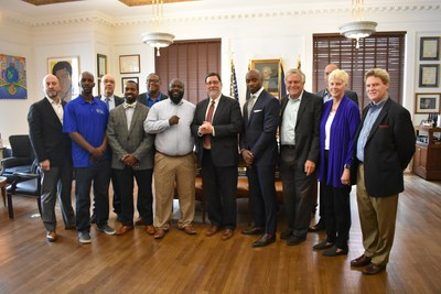 Dan Towriss, CEO of Group1001 (far left), Mubarik Ismaeli, president, Homewood Community Sports (sixth from the left), Pittsburgh Mayor William Peduto (seventh from the left), Pro Football Hall of Famer Curtis Martin (fourth from right), and Steve Salem, president & CEO, Cal Ripken, Sr. Foundation (far right), gather in Pittsburgh.