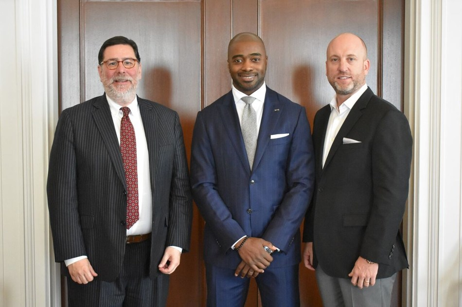 Pittsburgh Mayor William Peduto (left), Pro Football Hall of Famer Curtis Martin (middle), and Dan Towriss, CEO of Group1001 (right), gather in Pittsburgh.