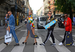 (L-R) River Viiperi, Jasmine Sanders (Golden Barbie), Jeremy Scott and WizKid stop traffic launching the CÎROC x Moschino collaboration during Milan Fashion Week in the centre