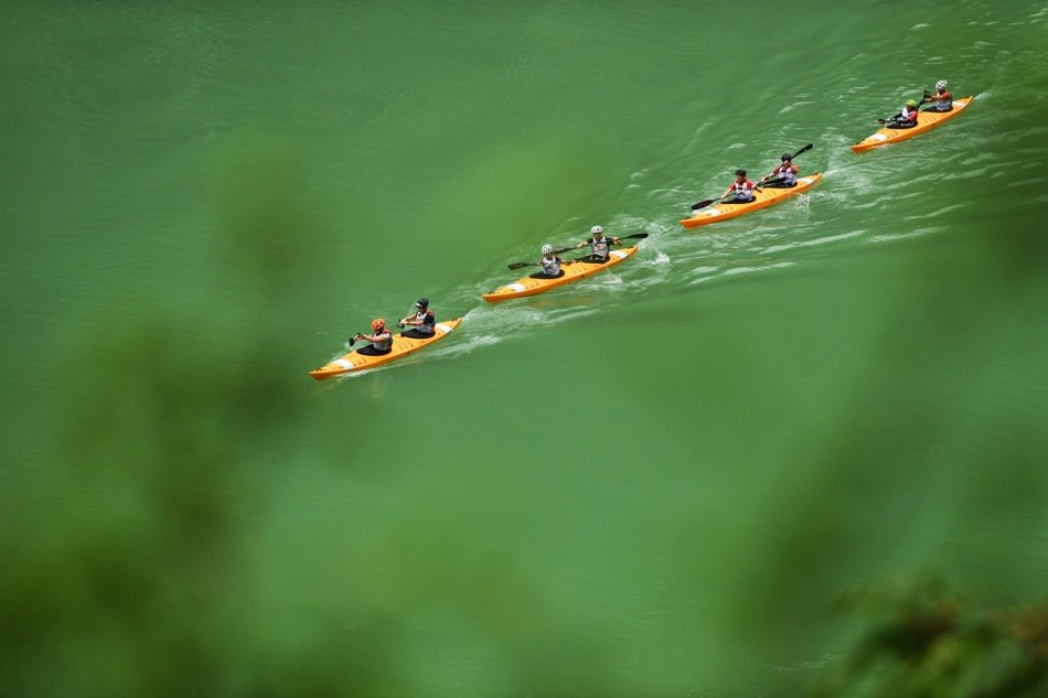 Contestants are racing in a kayak competition on September 18. (PRNewsfoto/Wulong Publicity Dept.)