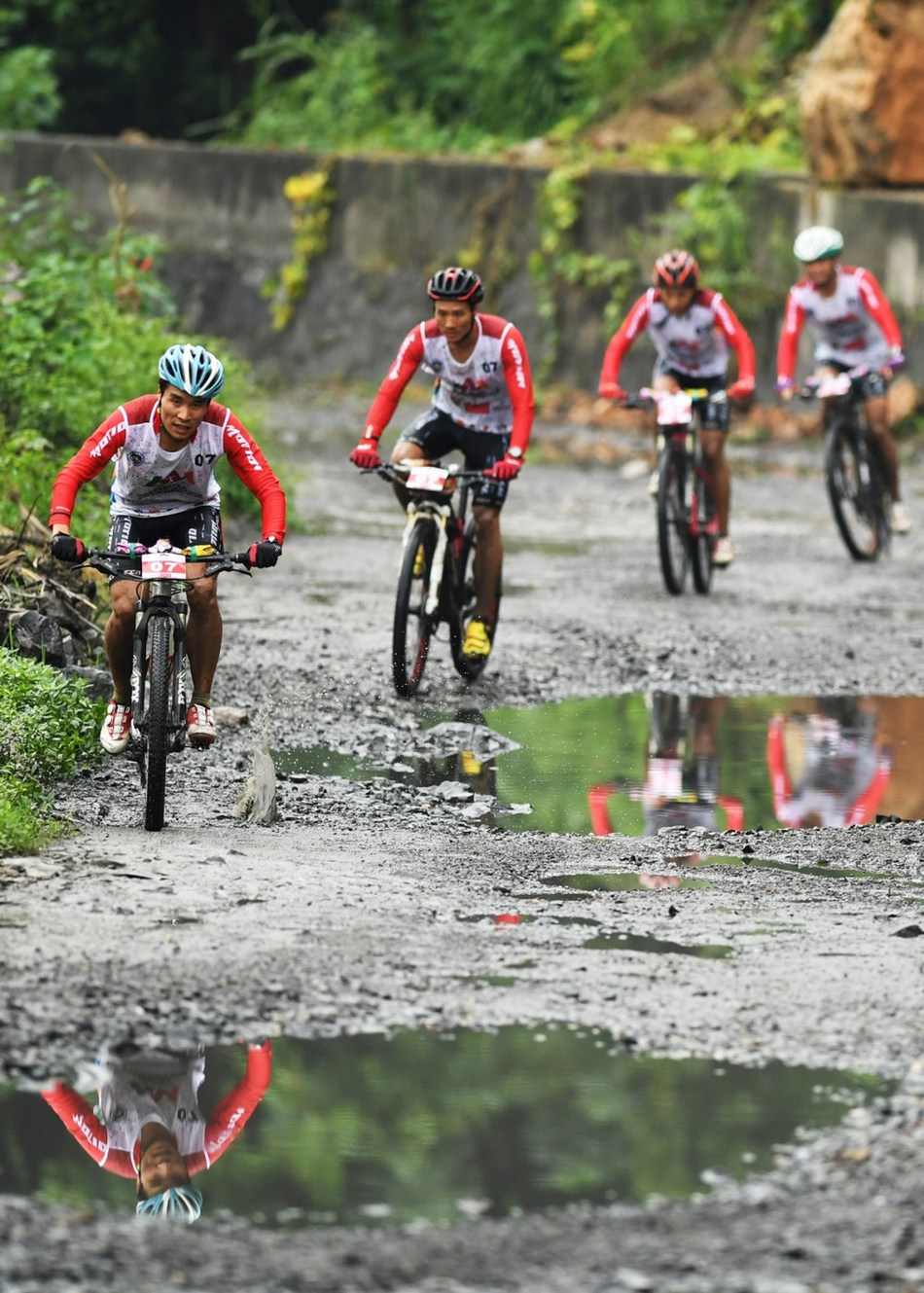 The team from the Zunyi Medical University are racing in the mountain bike cycling competition on September 18. (PRNewsfoto/Wulong Publicity Dept.)