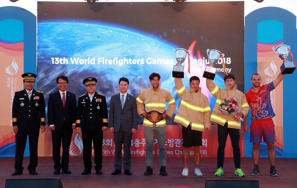 The winners of the 13th World Firefighters Games pose during an awards ceremony in Chungju, 147 km south of Seoul, on Sept. 17, 2018