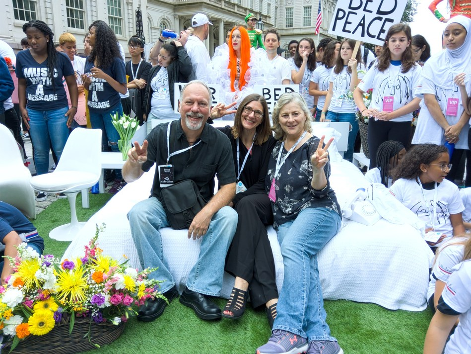 Bruce Mandel, Jen Soule and Patricia Strauch at the Lennon Bus's Come Together NYC residency kick-off event outside City Hall in New York. The John Lennon Educational Tour Bus is presented by OWC.