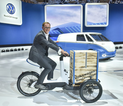 Dr. Thomas Sedran, Chairman of the Volkswagen Commercial Vehicles Board Board, riding the new Cargo e-bike, which was presented today at the IAA Commercial Vehicles (PRNewsfoto/VW Volkswagen Nutzfahrzeuge AG)